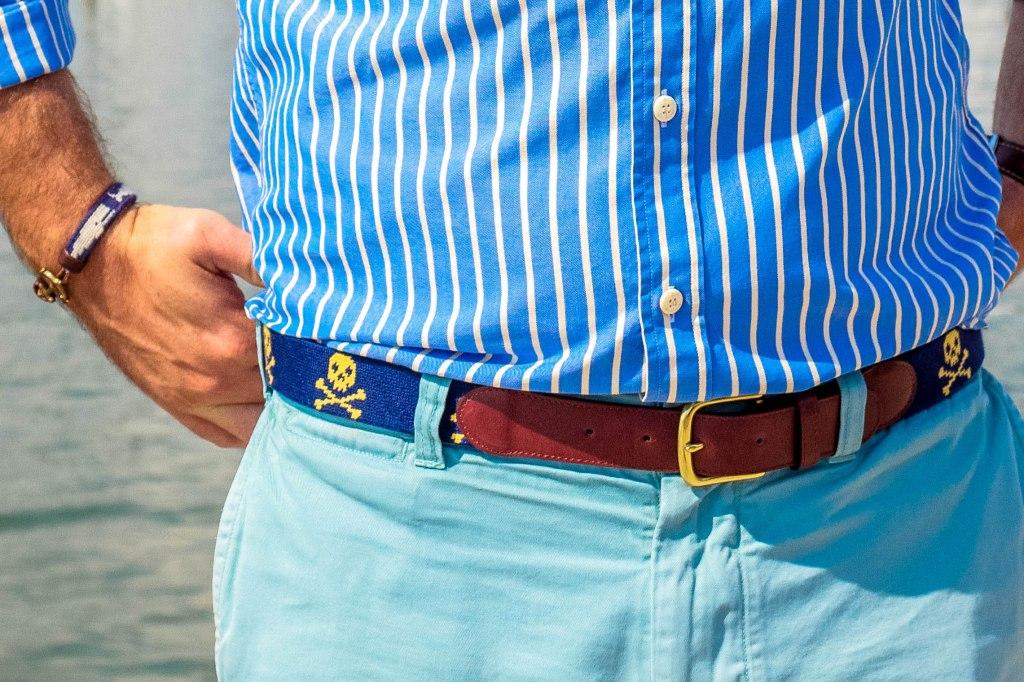 Tucker Blair Skull & Crossbones belt paired with a Tucker Blair x KJP whale needlepoint bracelet